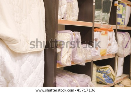 Shelf with blankets in a supermarket