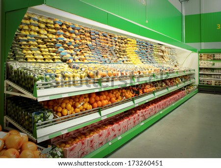 Shelf with citrus fruits, TM's removed, price tags left in place and contain no copyright. - stock photo