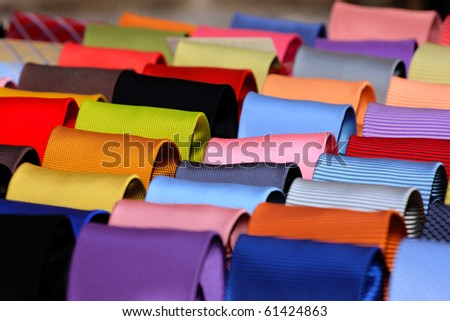 Shelf with diverse color ties - stock photo