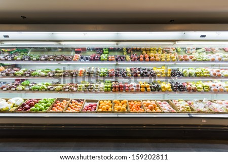 Shelf with fruits in supermarket - stock photo