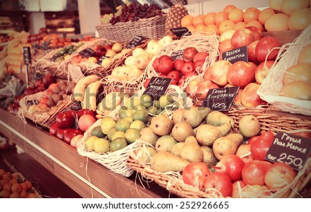 Shelf with fruits on a farm market, toned image - stock photo