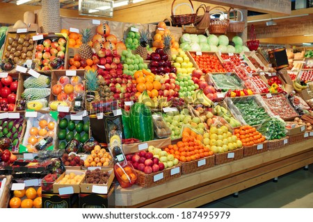 Shelf with fruits on a farm market, trademarks blurred or removed - stock photo