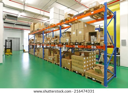 Shelf with goods in storage warehouse room - stock photo