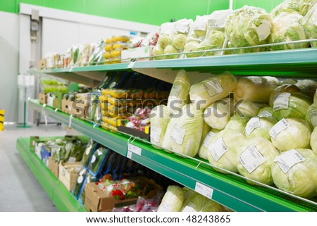 Shelf with groceries, TM's removed, price tags left in place and contain no copyright. - stock photo