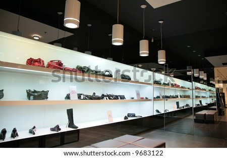 shelfs in store with bags and shoes - stock photo