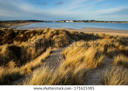 Shell Bay, Dorset, UK. Looking across the sand dunes to Shell Bay and the entrance to Poole Harbour.