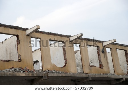 Shell of an old building under demolition - stock photo