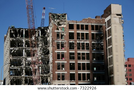 shell of building under demolition - stock photo