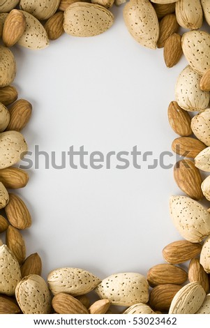 Shelled and un-shelled almonds creating a border - stock photo