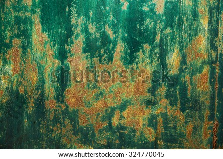 Shelled green paint on an old wall. - stock photo