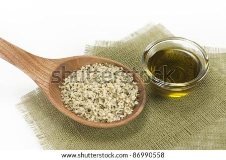 shelled hemp seeds and hemp oil - stock photo