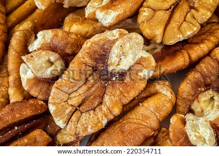 Shelled pecans on a wooden background. - stock photo