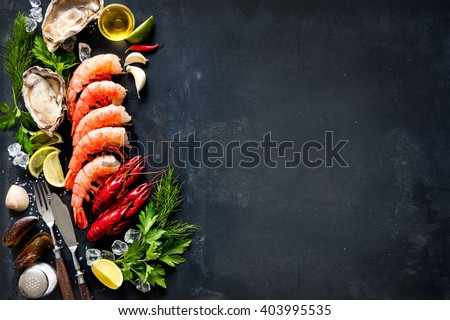 Shellfish plate of crustacean seafood with shrimps, mussels, oysters as an ocean gourmet dinner background - stock photo
