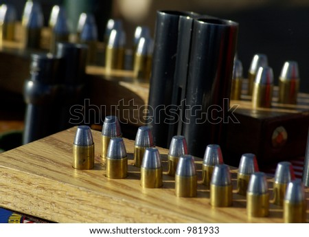 Shells and guns at a cowboy shooting competition.