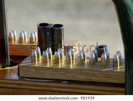 Shells and guns at a cowboy shooting competition. - stock photo