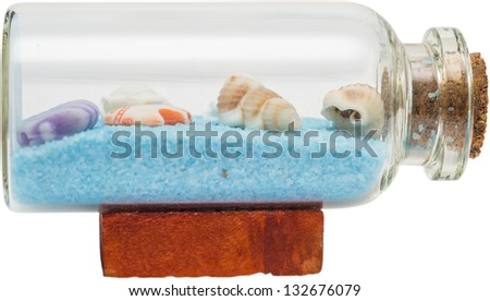 Shells In A Bottle Isolated On White - stock photo