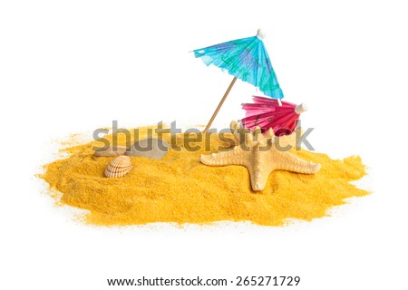 Shells, pebbles and umbrellas on yellow sand. Isolated on white. - stock photo
