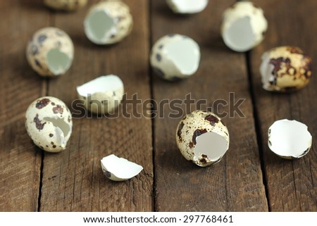 shells quail eggs on wooden background - stock photo