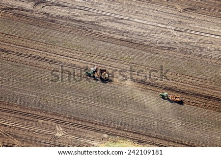 Shelly, Idaho, USA Oct. 18, 2014 An aerial view of a tractor and combine harvesting potatoes in a farm field.