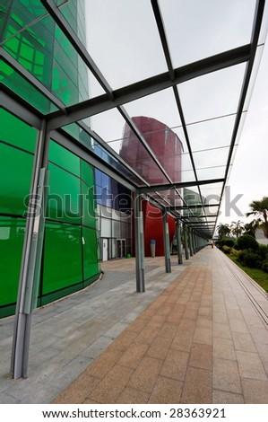 Sheltered walkway beside a modern shopping mall - stock photo