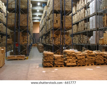 Shelves and pallets in a warehouse - stock photo