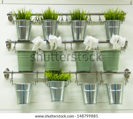Shelves for brushes and plant - stock photo