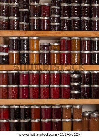Shelves of homemade jams and jellies preserves - stock photo