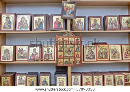 Shelves with beautiful religious icons for sale. - stock photo