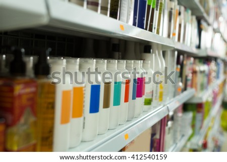 Shelves with different hair care products in  salon  - stock photo