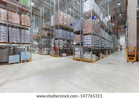 Shelves with goods in distribution center warehouse