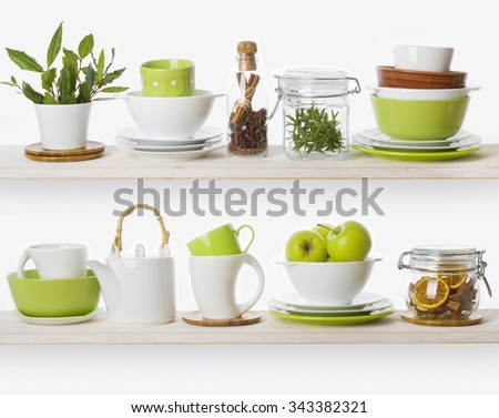 Shelves with various food ingredients and kitchen utensils - stock photo