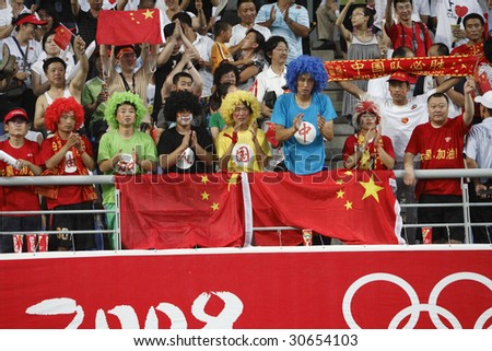 SHENYANG, CHINA - AUGUST 10:  Spectators cheer for the Chinese team prior to a Group C match between China and Belgium at the Beijing Olympic Games soccer tournament August 10, 2008 in Shenyang, China - stock photo