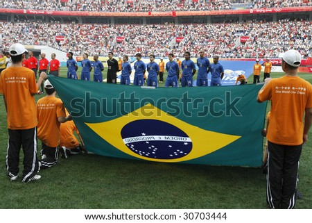 SHENYANG, CHINA - AUGUST 10:  The Brazilian team lines up for team introductions prior to a match against New Zealand at the Beijing Olympic Games soccer tournament August 10, 2008 in Shenyang, China. - stock photo