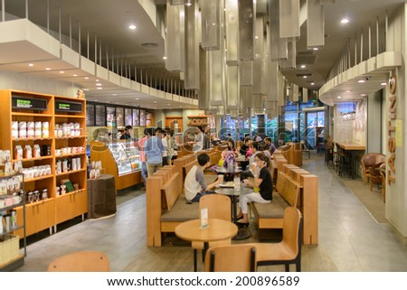 SHENZHEN, CHINA-APRIL 13: Starbucks Cafe interior on April 13, 2014 in Shenzhen, China. Starbucks Corporation is an American global coffee company and coffeehouse chain based in Seattle, Washington - stock photo