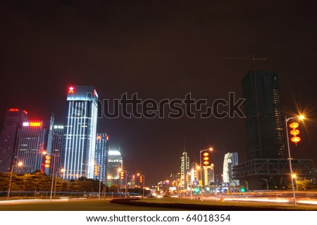 SHENZHEN, CHINA - AUGUST 26: Futian Central Business District at night on August 26, 2010. City center and civic center decorated and illuminated for 30th years anniversary of Shenzhen city.