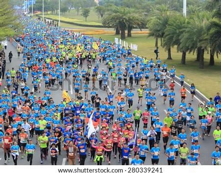 SHENZHEN,CHINA - DECEMBER 7: Marathon runners on the street at Shenzhen International Marathon DECEMBER 7, 2014 in Shenzhen, China  - stock photo