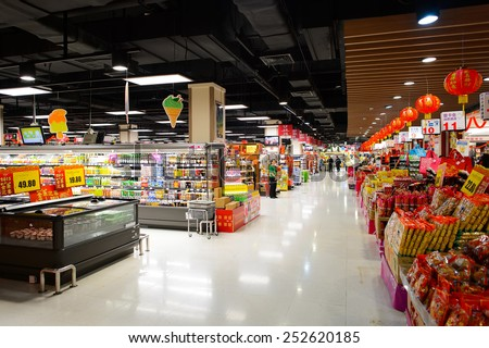 SHENZHEN, CHINA - FEBRUARY 04, 2015: AEON supermarket interior with Chinese New Year decorations. ShenZhen is regarded as one of the most successful Special Economic Zones. - stock photo