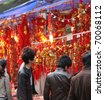 SHENZHEN, CHINA-JAN 26: People shop for Chinese New Year ornaments around the famous Dongmen Pedestrian Street on Jan 26, 2011 in Shenzhen, China, ahead of the Chinese New Year, the year of the rabbit - stock photo