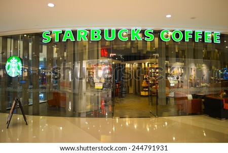 SHENZHEN, CHINA - JAN 06: Starbucks Cafe entrance on January 06, 2015. Starbucks Corporation is an American global coffee company and coffeehouse chain based in Seattle, Washington  - stock photo