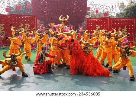 SHENZHEN, CHINA-JANUARY 22, 2009: Dance ensemble in the original unusual costumes in Folk Culture Villages. Chinese New Year Parade. - stock photo