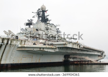Shenzhen, China - January 23, 2016: Soviet aircraft carrier Minsk in a military theme park Minsk World in chinese city Shenzhen. The aircraft carrier Minsk was part of the Soviet Pacific Fleet.