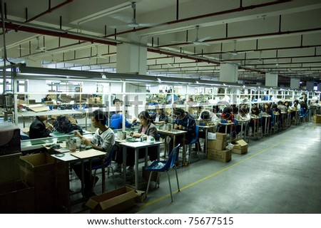 SHENZHEN, CHINA - MARCH 11: GO-ON earphone factory produces wireless earphones - 2,4GHz and RF/UHF system which works even 100 meters away from transmitter. Assembly line on March 11, 2011 in Shenzhen, China. - stock photo