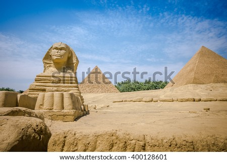 Shenzhen, China - 27 March 2016:  Great Sphinx of Giza and pyramids in Window of the World. It has about 130 reproductions of some of the most famous tourist attractions. - stock photo