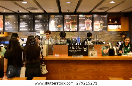 SHENZHEN, CHINA - MAY 17, 2015: Starbucks cafe interior. Starbucks Corporation is an American global coffee company and coffeehouse chain based in Seattle, Washington  - stock photo