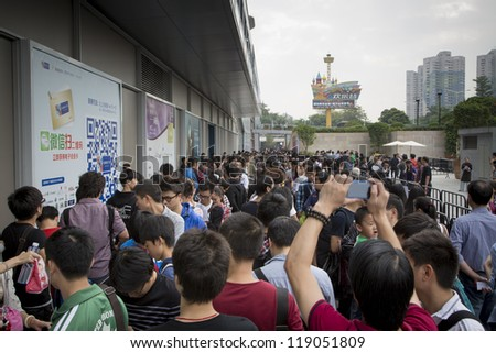SHENZHEN, CHINA - NOV. 3: Fans gathering outside the new Apple store at Shenzhen, China. Apple open its seventh Apple store in mainland China, located in SHENZHEN on November 3, 2012. - stock photo