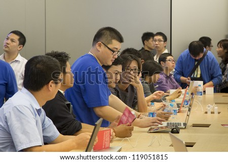 SHENZHEN, CHINA - NOV. 3: Inside the new Apple store. Apple open its seventh Apple store in mainland China, located in SHENZHEN on November 3, 2012. - stock photo