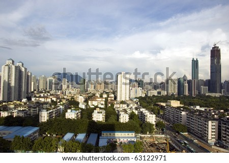SHENZHEN, CHINA - SEPTEMBER 14: Luohu district with two highest skyscrapers in Shenzhen on September 14, 2010. Shun Hing Square, named also as DiWang - 384 meters and Kingkey Finance Tower.