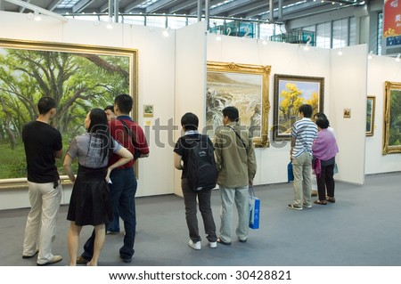 SHENZHEN, GUANGDONG- MAY 16: Visitors admire modern and ancient Chinese art paintings and graphics made in ink at China International Cultural Industries Fair May 16, 2009 in Shenzhen, Guangdong China