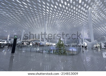 SHENZHEN - JULY 14 : Airport interior on July 14, 2014 in Shenzhen, China. Shenzhen Bao'an International Airport is located near Huangtian and Fuyong villages in Bao'an District, Shenzhen, Guangdong - stock photo
