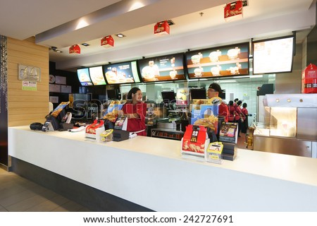 SHENZHEN - NOV 06: McDonald's restaurant on November 06, 2014 in Shenzhen, China. The McDonald's Corporation is the world's largest chain of hamburger fast food restaurants - stock photo